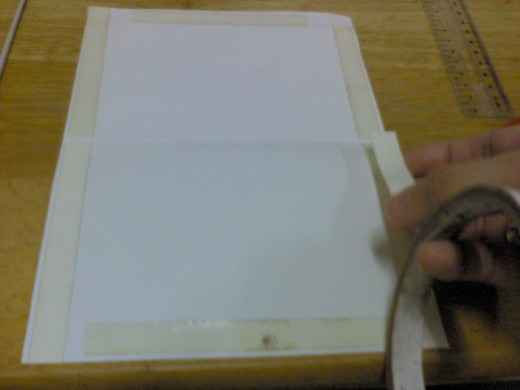 apply double-sided tape on 4 sides, including the top and bottom of the card