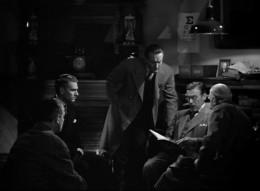 Laurence Olivier, George Sanders and Leo G. Carroll