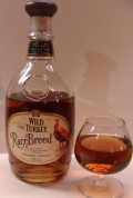Bottle and glass of Wild Turkey Rare Breed bourbon.