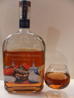 Bottle and glass of Woodford Reserve bourbon.