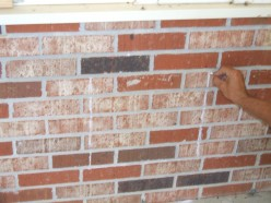 It's great if you are able to line up at least one side of the cut--not to mention the top and/or bottom--with either end of the brick or a mortar joint..Unfortunately for us, this cut had to be centered for cosmetic purposes.