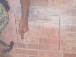 With the cuts made as deep as possible, it's no time to start removing the brick.