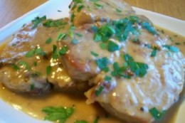 Smothered Pork Chops Are So Delicious. In this photo they are sprinkled with fresh dried crumbled parsley.