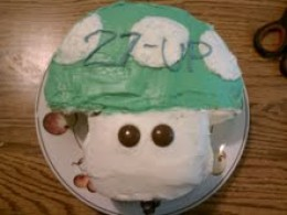 Make your Nintendo fan squeal with a Super Mario 1-up Mushroom birthday cake!
