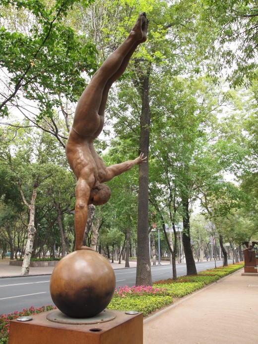 """Equilibrista en un Brazo Monumental (Monumental Equilibrist in One Arm)"" 2002. Bronze Sculpture by Mexican Artist Jorge Marin. Mexico City Open Air Exhibit at ""Paseo de la Reforma (Chapultepec)""."