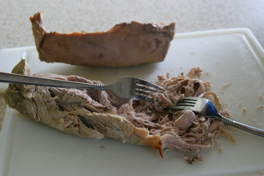 Pull two forks in opposite directions to shred the meat.