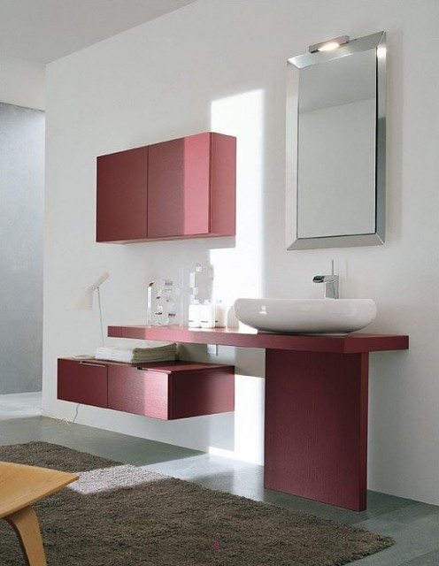 Contemporary style bathroom featuring pink accents and a brown shag rug.