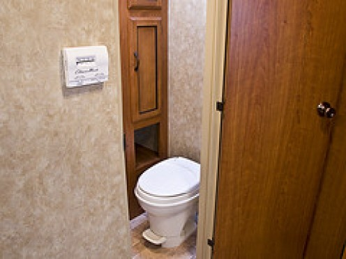 A typical trailer toilet is made of plastic.  Don't break it by stepping on it!