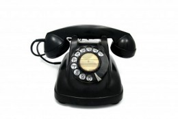 Old desk phone with rotary dial