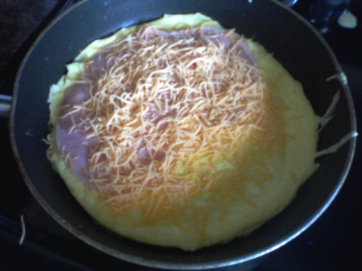 Omelet with cheese, ham, and more cheese.