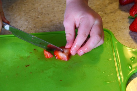 My six year old cuts the strawberries with a butter knife.