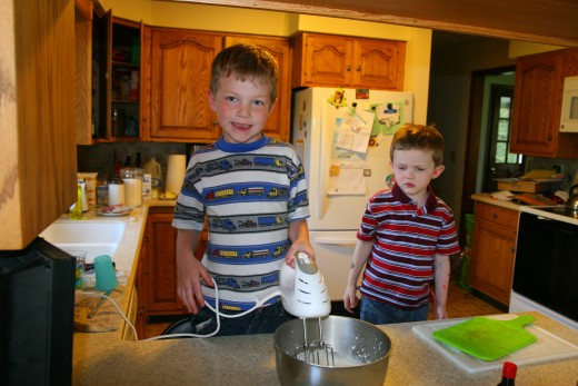 Matthew operates the electric mixer to make whipped cream.