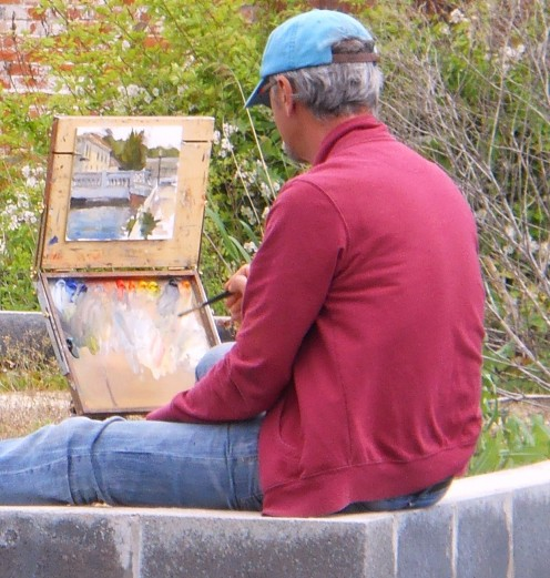 David Diaz painting a riverfront scene in Historic Milton.