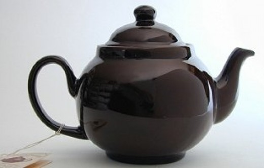 """Traditional terracotta """"Brown Betty"""" teapot."""