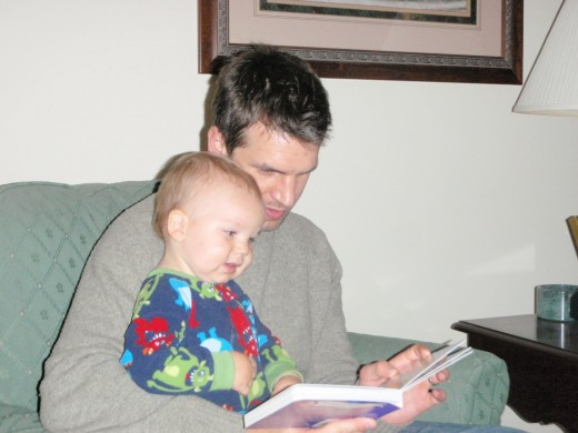 A beautiful sight - a boy and his father reading books together...