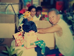 Mama and Papa taking out hand-me-down treasures to be given away.