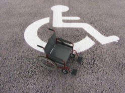 Illegal parking in a handicap space could result in a ticket of $100 or more