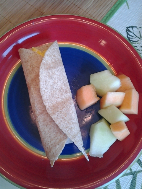 Egg and Cheese Breakfast Wrap with Fresh Melon