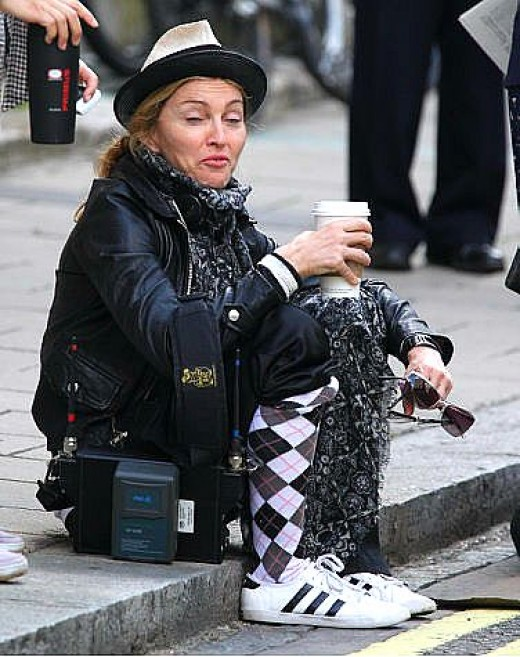 "Madonna loses her ""Material Girl"" image in this candid photo."