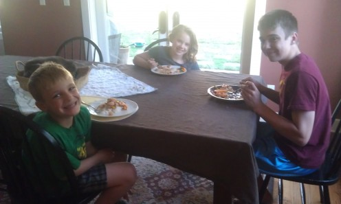 My kids enjoying Garlic Shrimp and Rice