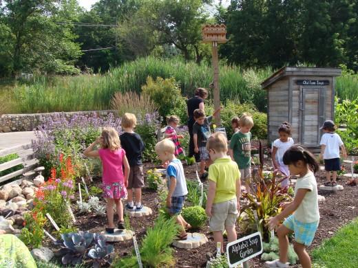 Grace and Alex explore an alphabet garden.