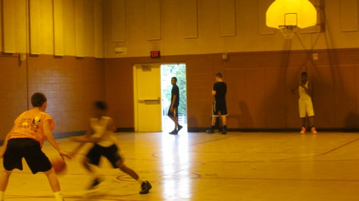 Residents of the community practice basketball in the gymnasium of Robert C. Wilson Center