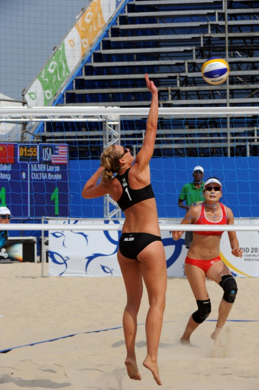 Women playing volleyball.