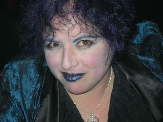 Here I am, made up for a special event, the Portland Vampire Masquerade Ball.  My makeup that night matched my blue-purple hair.