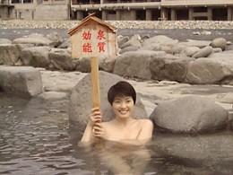 A woman enjoying a hot spring.