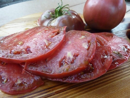 Smaller tomatoes ripen first. These big 12 ounce  slicers take several days longer to sun ripen.