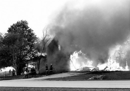 Our home totally engulfed in flames and smoke