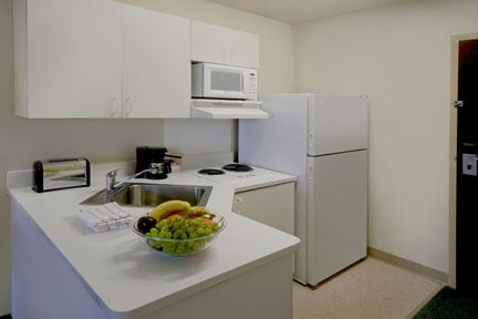 Full size fridge, electric range, and microwave. Only Deluxe locations have a dishwasher and stove.