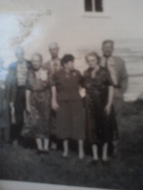 My grandmother with family in Elma, Iowa many years ago. The photo is very old.