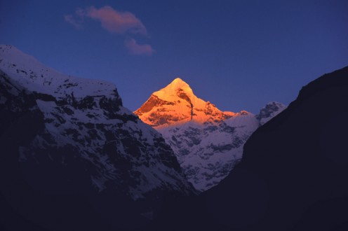 The Neelakant Parvat at Badrinath is venerated as Lord Shiva who consumed the deadly poison. To keep the Lord cool, the story goes, the mountain is always covered in snow. Everyday, the first rays of the sun hit this peak and slowly uncover it.