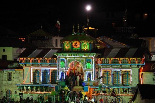 The Badrinath temple at night. It is believed that Sage Narada performs worship for 6 months when the shrine is closed. When doors are re-opened, lamps are lit and flower worship is found!