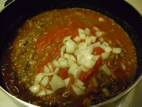 Tomato sauce and onions have been added.
