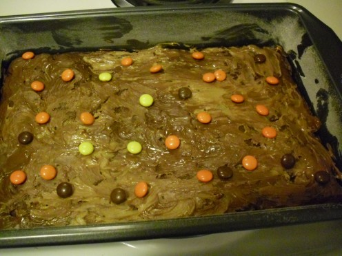 Add Reese's Pieces candies on top, if desired.