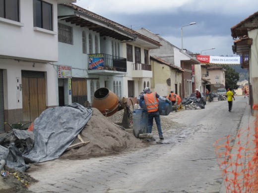 Workers pouring new concrete on the corner of Mariscal Sucre and Coronell Guillermo Talbot