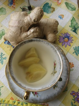 A dainty cup of freshly-brewed ginger tea.
