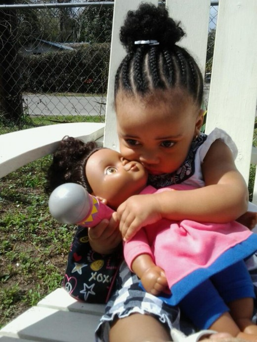 Selah and her doll ;) ( My 1 year old great cousin)