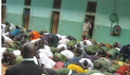 Prisoners in prayer at Mukobeko Maximum Prison in Kabwe, Zambia.