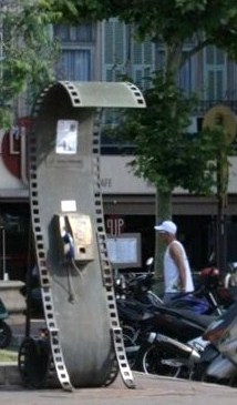 Across from the Palais, a public telephone assumes the guise of a section of film.