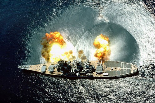 USS. Iowa firing her guns broadside - Notice the shock waves in the ocean.