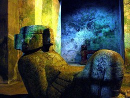 Image of the God Chac Mool, located inside a chamber in the Temple of Kukulkán, at Chichén Itzá. Behind of the God, the statue of the Jade Eyed Jaguar. Picture taken without flash to avoid damage to the original colors of the structures.