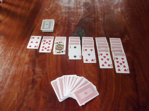 Using a deck of cards to play Solitaire manually can be frustrating when you lay out the cards only to find the game is over in a few moves.