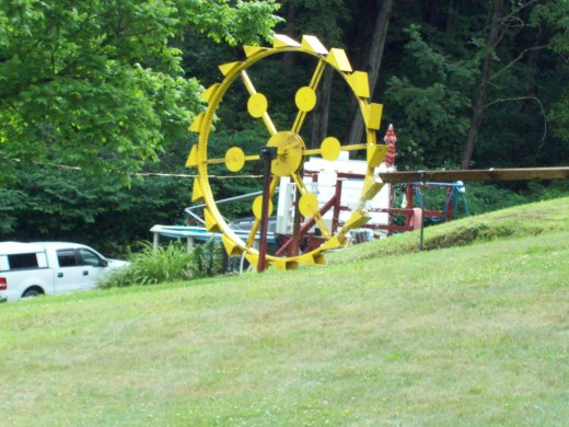 This is a water wheel my uncle has erected at the corner of his yard.