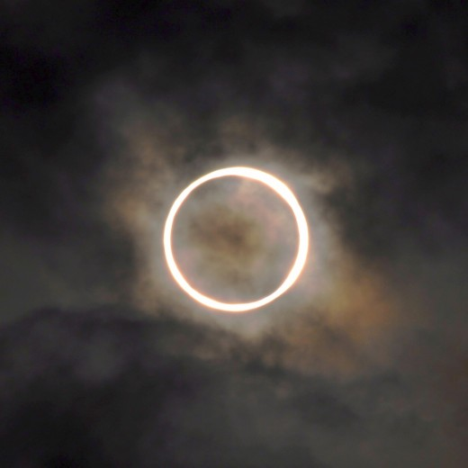 "A stormy dawn over Tokyo did not prevent viewers from seeing the full ""ring effect"" of a rare annular eclipse. Here's a beautiful photo by Noboyuki Hayashi."