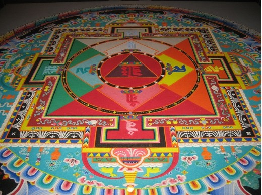 Tibetan monks create the intricate geometric patterns in coloured sand as an act of meditation.  Symbolcally,  the mandalas represent the cosmos.