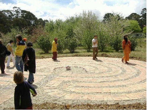 The labyrinth is an embodiment of a mandala in four dimensions.  Participants of all ages walk it mindfully, slowly, spiralling to the centre, and then returning.