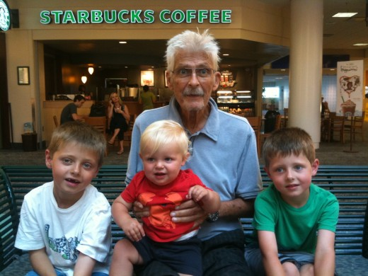 At the airport in Jacksonville, FL.  The first time my father was in the company of my three boys after undergoing a life-saving surgery.